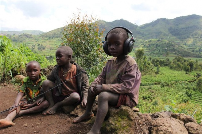 Boy with Headphones at Mperwa Batwa community