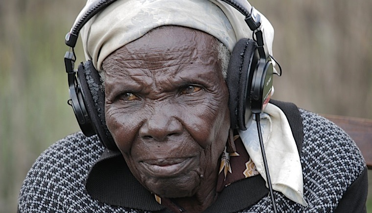 80-year-old-widow-of-one-of-the-musicians-listening-to-the-music-her-husband-recorded-in-the-1950s-760-x-435